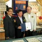 Xu TianHong is presented with a certificate of welcome from Markham mayor Frank Scarpitti from Councillors Alan Ho and Gordon Landon.