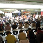 GM Lu Qin plays 18 opponents before a large audience at New Kennedy Square.