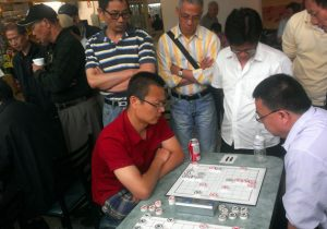 Mark Wang (left), early in the tournament