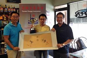 Li YaChao accepts the winner's trophy