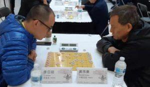 Li Yachao (L) vs. Huang Xulian of Calgary